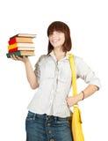 Scolara con i libri Immagini Stock