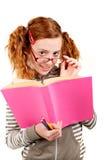 Scolara con il libro Immagini Stock