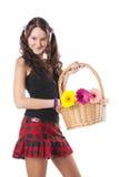 Scolara con un cestino dei fiori fotografia stock libera da diritti
