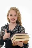 Scolara sorridente con i libri Fotografia Stock