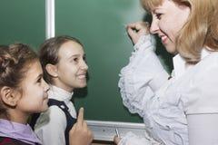 Scolare ed insegnante Fotografie Stock