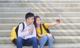 Scolari, maschio e femminile asiatici immagini stock
