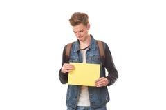 Scolaro che posa con la carta in bianco Fotografia Stock