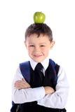 Scolaro con la mela fotografia stock