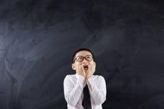 Scolaro spaventato che morde le sue unghie Fotografia Stock Libera da Diritti