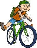 Scolaro su una bici Fotografie Stock Libere da Diritti