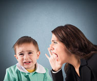 Scold a child. Woman screaming to a crying baby boy Royalty Free Stock Images