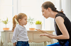 Scold. A mother scolds her child Stock Photo