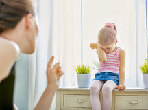 Scold. A mother scolds her child Stock Image