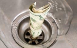 Scolo dei soldi Immagine Stock