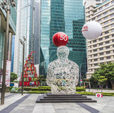 Scolpisca l'anima di Singapore da Jaume Plensa nel centesimo finanziario Fotografia Stock