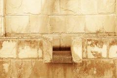 Scolpisca la parete dell'argilla fotografia stock