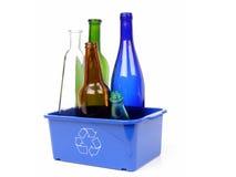 Scomparto blu di eliminazione e bottiglie di vetro di colore Immagine Stock Libera da Diritti