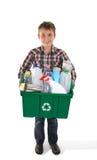 Scomparto di riciclaggio della holding del ragazzo in pieno o rifiuti Immagini Stock Libere da Diritti
