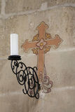 Sconce and cross Stock Photo