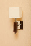 Sconce on the wall. Modern sconce with textile lampshade on the wall Stock Image