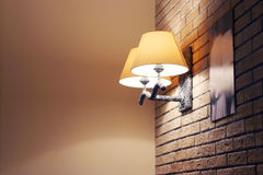 Sconce with yellow lamp shade on brick wall Royalty Free Stock Photography