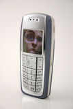 Sconcertante da tecnologia/cellulare divertente (telefono delle cellule della maschera) Immagini Stock Libere da Diritti