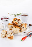 Sconces with afternoon tea items over white background Royalty Free Stock Photos