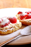 Scone. Photograph of a scone with strawberries and cream Stock Photo