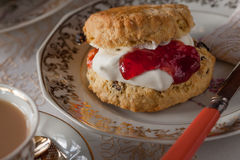 Scone with cream and jam royalty free stock image