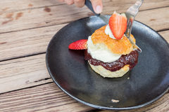 Scone with cream and strawberry jam Royalty Free Stock Photo