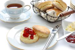 Scone , cream tea , afternoon tea. Scone with strawberry jam and clotted cream , cream tea , devonshire tea , tea party , afternoon tea Stock Photo