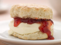 Scone Filled with Strawberry Jam and Clotted Cream Royalty Free Stock Photo