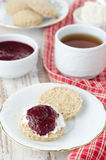 Scone with goat cheese and jam for breakfast Stock Photo