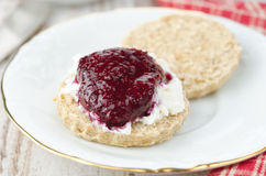 Scone with goat cheese and jam on a plate closeup Royalty Free Stock Photography