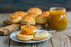 Scone with homemade orange jam. Royalty Free Stock Photos