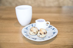 Scone and hot tea on wood table Royalty Free Stock Photos