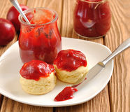 Scone with jam. On a brown table Royalty Free Stock Photography
