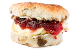 Scone with jam and clotted cream. Scone with strawberry jam and clotted cream on a white background Royalty Free Stock Photos