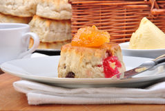 Scone with jam on a timber board Stock Photography