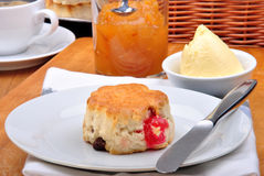 Scone with  jam on a timber board Stock Images