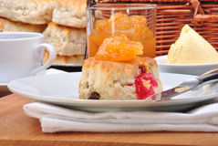 Scone with jam on a white plate Stock Photo