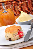 Scone with jam on a white plate Royalty Free Stock Image