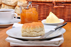 Scone with jam on a white plate Royalty Free Stock Photography