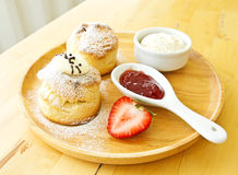Scone spread. With cream and strawberry jam Royalty Free Stock Images