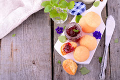 Scone with strawberry jam, afternoon tea , Royalty Free Stock Photos
