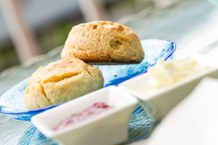 Scone with strawberry jam Royalty Free Stock Images