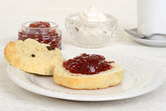 Scone with strawberry jam Stock Images