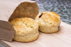 Scone on wooden plate Stock Photography