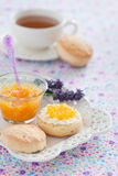 Scones. Orange scones with lavender, served with fresh cheese and orange jam, selective focus Royalty Free Stock Photography
