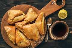 Scones with apple and mango and cup of tea. Royalty Free Stock Photos