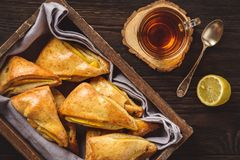 Scones with apple and mango and cup of tea. Stock Images
