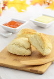 Scones with butter and jam. Fresh baked scones with butter and apricot jam Royalty Free Stock Photography