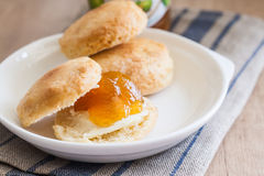 Scones with butter and jam on a napkin and Bank of jam Stock Image