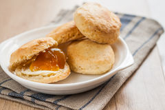 Scones with butter and jam on a napkin and Bank of jam Royalty Free Stock Image